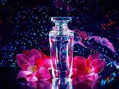 image of perfume  - female perfume and pink flowers on dark background - JPG