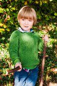 foto of pullovers  - Outdoor portrait of a cute little boy - JPG