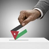 Black Male Holding Flag. Voting Concept - Jordan