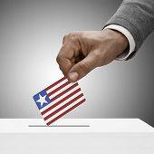 Black Male Holding Flag. Voting Concept - Liberia