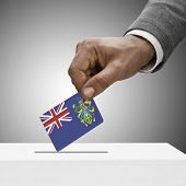 Black Male Holding Flag. Voting Concept - Pitcairn Island