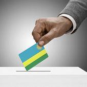 Black Male Holding Flag. Voting Concept - Rwanda