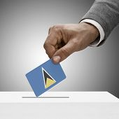 Black Male Holding Flag. Voting Concept - Saint Lucia