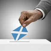 Black Male Holding Flag. Voting Concept - Scotland