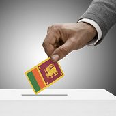 Black Male Holding Flag. Voting Concept - Sri Lanka