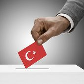 Black Male Holding Flag. Voting Concept - Turkey