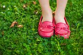 Close up of red moccasins on child's feet