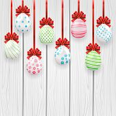 Easter Eggs With Red Bow On Wooden Background