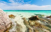 foto of crystal clear  - Rocks in beautiful turquoise crystal clear sea water - JPG