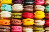 Colorful macarons in rows in a box, more than 20 flavors