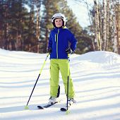 Portrait Of Professional Skier Boy Dressed In Sportswear And Helmet, Sunny Winter Day
