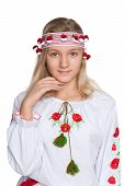 stock photo of preteen  - A pretty preteen Ukrainian girl against the white background - JPG