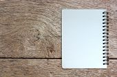 White Page Of Notebook On Wood Texture