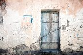 image of abandoned house  - Old blue door of a abandoned house - JPG