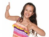 foto of preteen  - A happy preteen girl holds her thumbs up on the white background - JPG