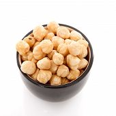 Bowl With Hazelnuts Over White Background