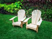 picture of lawn chair  - Wooden chairs on a green lawn. Summer garden.
