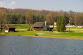 House by the Pond in Amish Country in Spring