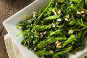 stock photo of sauteed  - Homemade Sauteed Green Broccoli Rabe with Garlic and Nuts - JPG