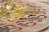 Gel capsules and euro banknotes
