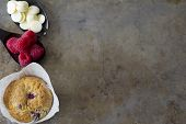 Raspberry Muffins from Above with Raspberries and Chocolate
