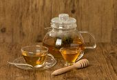 Glass Cup And Teapot With Green Tea With Honey
