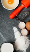 Baking Ingredients (eggs, Flour, Milk, Eggshell And Rolling Pin)