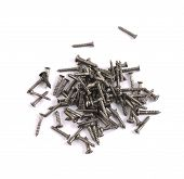 Pile of metal screws isolated