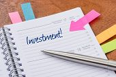 A daily planner with the entry Investment