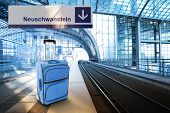 Departure For Neuschwanstein, Germany. Blue Suitcase At The Railway Station