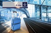 Departure For Koln, Germany. Blue Suitcase At The Railway Station
