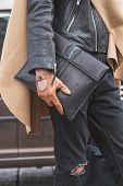 Detail Of A Man Outside Gucci Fashion Show Building For Milan Women's Fashion Week 2015