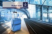 Departure For Rotterdam, Netherlands. Blue Suitcase At The Railway Station