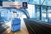 Departure For Copenhagen, Denmark. Blue Suitcase At The Railway Station