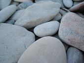 Stones Pebbles On The Beach. Figures From The Stones.