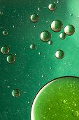 Green oil and water abstract background