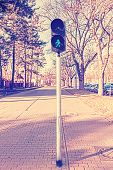 Retro Filtered Photo Of Traffic Lights, Green Color.