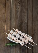 Three skewers with shrimps