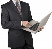 Man In A Dark Business Suit Pointing At A Laptop