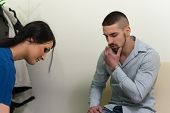 image of she-male  - Young Man Pressing His Bruised Cheek With A Painful Expression As If She - JPG