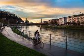 Two Bikes Next To Salzach River Of Salzburg
