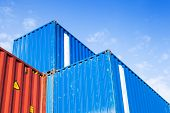 Blue And Red Metal Industrial Cargo Containers Are Stacked