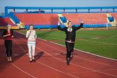 stock photo of race track  - business people running together on racing track - JPG