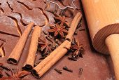 stock photo of christmas spices  - Spice for baking anise cinnamon cloves cookie cutters and rolling pin on dough for gingerbread concept for baking and christmas time - JPG