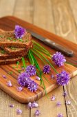 picture of chive  - Organic rye bread with fresh chives selective focus vertical - JPG