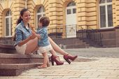 picture of eat me  - girl and mother have fun with ice cream on street - JPG