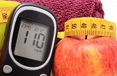 picture of diabetes  - Glucometer fresh apple and tape measure concept for diabetes lifestyle and healthy nutrition - JPG