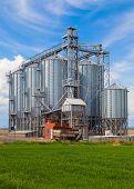 stock photo of silos  - Industrial silos under blue sky - JPG