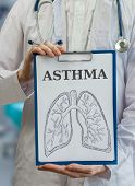picture of asthma  - Doctor holds clipboard with asthma diagnosis and asthmatic lungs drawing - JPG