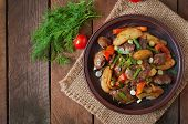 stock photo of liver fry  - Roast chicken liver with vegetables on wooden background - JPG